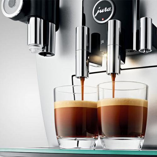 Jura Coffee Machine - close up of two coffees being made